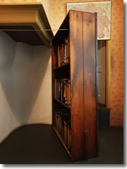 A bookcase swung aside to reveal teh hidden staircase up to the apartment where Anne Frank hid with her family from the Nazi occupation of Amsterdam
