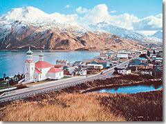 The red and green roof of a Russian-Orthodox-style church brings a spot of color to the mountainous winter landscape on Alaska's Marine Highway.