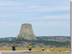 Motorcycles en route to the Sturgis Rally roar past Devils Tower in Wyoming