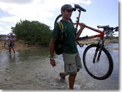La Dulce Vida owner Karl Husson leads the way across a stream on Vieques