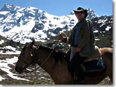 The author astride Canella high in the Andes Mountains of Chile.