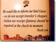 These days, businesses go out of their way to avoid getting traveler's checks—inlcuding this Italian hotel, but also (in my experience) even banks, who will either refuse to cash checks for non-clients, or will limit the amount you can change at a time to somethgin ludicrously small like $100..