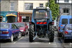 A tractor parked in a town square in Ireland